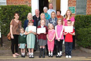 Winners with family, museum volunteers and census co-ordinator Dave Moore