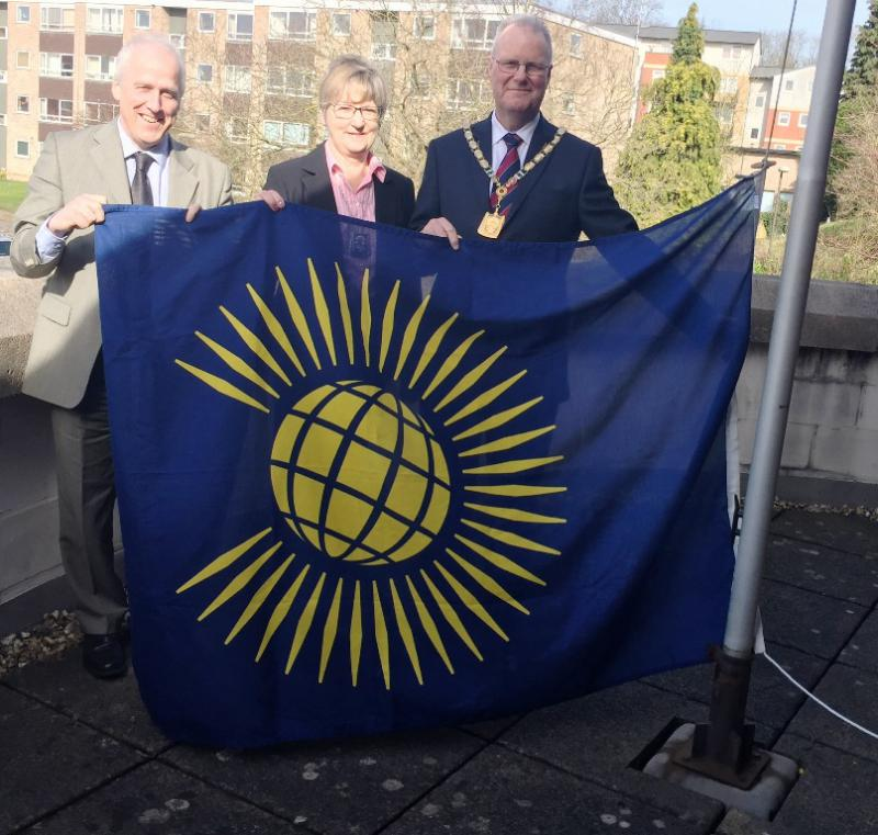 commonwealth-day-steven-alison-and-andrew-with-the-flag.jpg