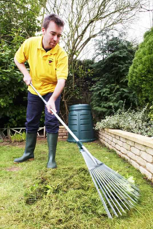 web0590-man-raking-grass-cuttings-in-garden-shot-1-web-version-72ppi.jpg
