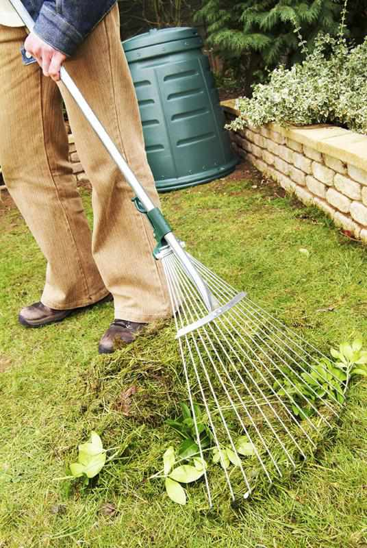 web0592-man-raking-grass-cuttings-in-garden-shot-3-print-version-300ppi.jpg
